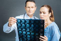 Medical professionals counseling over patient diagnosis together. Cooperative relations. Waist up shot of medical colleagues standing next to each other while Royalty Free Stock Images