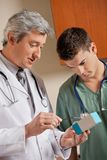 Medical Professionals Looking At Medicine Box Stock Photography