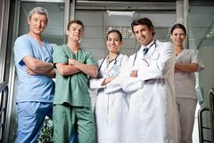 Medical Professionals Standing With Hands Folded Royalty Free Stock Photos