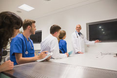 Medical professor teaching young students Royalty Free Stock Photos