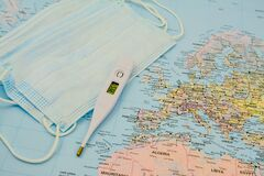 Medical protective mask on world map. Covid-19.face mask, thermometer. Virus in Europe