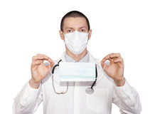 Medical protective mask. Young male doctor holding a medical protective mask Royalty Free Stock Photography