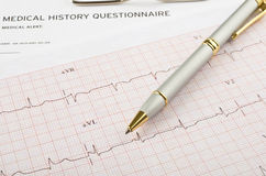 Medical questionnaire and cardiogram Royalty Free Stock Image