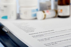 Medical questionnaire with medicine bottles Royalty Free Stock Photography
