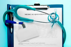Medical questionnaire with stethoscope and ID tag Stock Photo