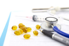 Medical questionnaire, stethoscope, pen and Fish oil capsule Stock Image