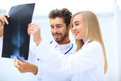 Medical and radiology concept - two doctors looking at x-ray Stock Images