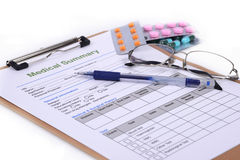 Medical record. Blank medical record and some pill on white background Stock Image