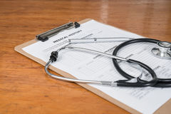 Medical Record on Clipboard with Stethoscope Stock Image