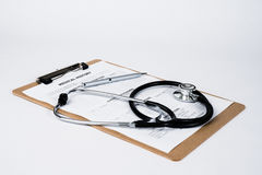 Medical Record on Clipboard with Stethoscope Royalty Free Stock Photo
