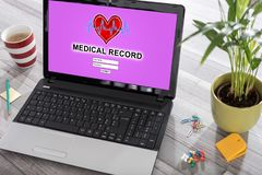 Medical record concept on a laptop. Laptop on a desk with medical record concept on the screen royalty free illustration