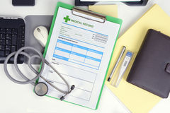 Medical record on desk. Stock Image