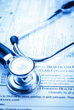 Medical record form with a stethoscope Royalty Free Stock Images
