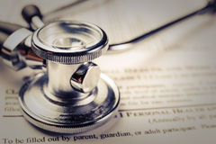 Medical record form with a stethoscope. Close up royalty free stock images