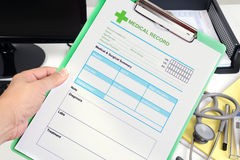 Medical record in hand. Stock Images