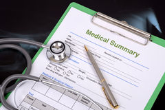 Medical record. Stethoscope and pen on blank medical record Royalty Free Stock Image