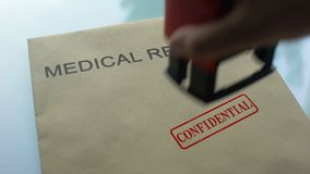 Medical records confidential, stamping seal on folder with important documents