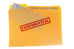 Medical records. Envelope attached to a  file-folder with Confidential text, isolated on white