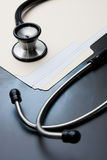 Medical Records with X Ray and Stethoscope Stock Images
