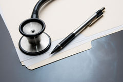 Medical Records with X Ray and Stethoscope Royalty Free Stock Images