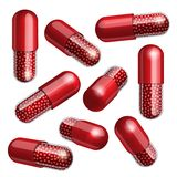 Medical red capsule with granules Royalty Free Stock Photo