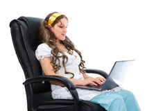 Medical remote support by sexy nurse sitting in armchair Royalty Free Stock Images