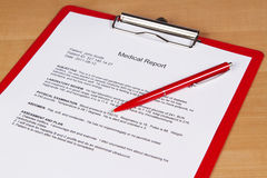 Medical report. On a red holder Royalty Free Stock Photography
