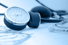 Medical report and sphygmomanometer Stock Image