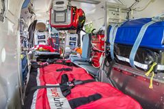 Medical rescue helicopter interior equipment. AHLEN, GERMANY - JUN 5, 2016: DRF Luftrettung German Air Rescue BK-117 helicopter interior Stock Image