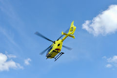 Medical rescue helicopter. Yellow medical helecopter on blue sky Stock Images