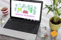Medical research concept on a laptop. Laptop on a desk with medical research concept on the screen stock images