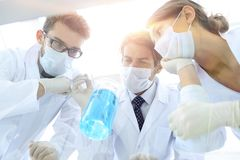 Medical researcher microbiology experiment in the laboratory. Scientists in the laboratory wearing protective goggles, looking at the flask stock photos