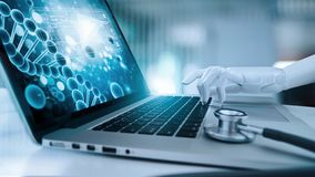 Medical robot hand touching laptop and analysis data human DNA. AI. artificial intelligence, innovation and futuristic, medical