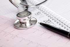 Medical Schedule. A stethoscope on a calender and a cardiogram printout Stock Images