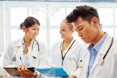 Medical school students in apprenticeship. Learning together in workshop royalty free stock images