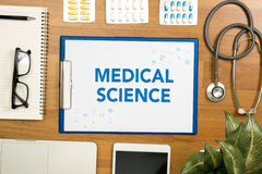 MEDICAL SCIENCE. Professional doctor use computer and medical equipment all around, desktop top view Royalty Free Stock Photos