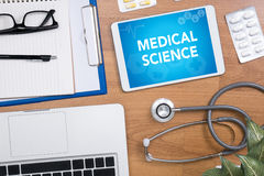 MEDICAL SCIENCE. Professional doctor use computer and medical equipment all around, desktop top view Stock Image