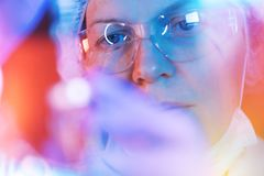 Medical science researcher performing test in laboratory stock image