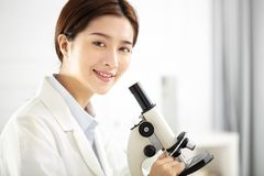 Medical or scientific researcher working in office Stock Images