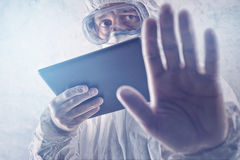 Medical Scientist Reading About MERS Virus on Figital Tablet Com Royalty Free Stock Image