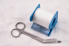 Medical scissors, gauze and tape. Medical scissors, gauze and paper tape Royalty Free Stock Photos