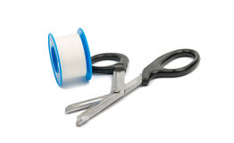 Medical scissors with plaster Stock Photo