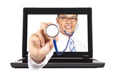 Medical service from internet. Healthcare and medical service from internet.doctor's hand with stethoscope Stock Photos