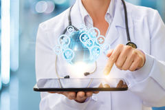 Medical services around the world in the tablet. Medical services around the world in the tablet of the doctor Stock Photo