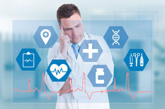Medical services with pensive doctor and medical signs Royalty Free Stock Photos