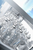 Medical solutions in bottles. Standing in warehouse Stock Images