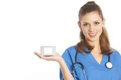 Medical specialist. Smiling young female medical specialist holding in her hand box with copy-space Stock Images