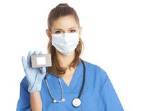 Medical specialist. Young female medical specialist in mask and gloves holding in her hand box with copy-space Royalty Free Stock Photography