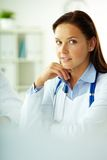 Medical specialist. Portrait of confident female doctor looking at camera in hospital Royalty Free Stock Image