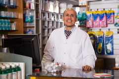 Medical specialist  in apothecary. Friendly medical specialist consulting in apothecary Royalty Free Stock Image